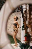 girl takes outdoor shower in the garden