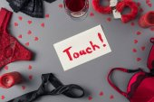 Fotografie top view of note with word touch between panties and handcuffs, valentines day concept