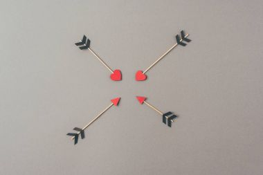 top view of four arrows on gray surface, valentines day concept