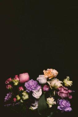 beautiful tender fresh blooming flowers isolated on black