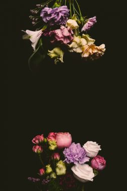 composition of beautiful tender fresh blooming flowers isolated on black