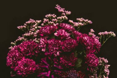 close-up view of beautiful tender pink flowers isolated on black