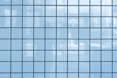 Blue glossy tiles wall pattern