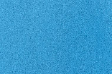 Surface of blue rough textured light wall