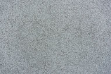 Old grey plaster on wall background