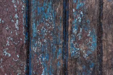 Old paint cracks on wooden surface background