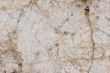 Stone wall with cracks light texture background