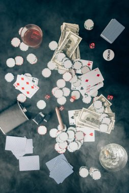 Smoke over chips and money on casino table