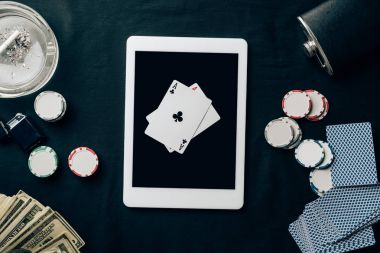 Online gambling with playing cards and chips by digital tablet
