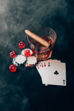 Gambling concept with whiskey on casino table with cards and dice