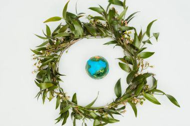 top view of leaves wreath with model earth isolated on white, earth day concept