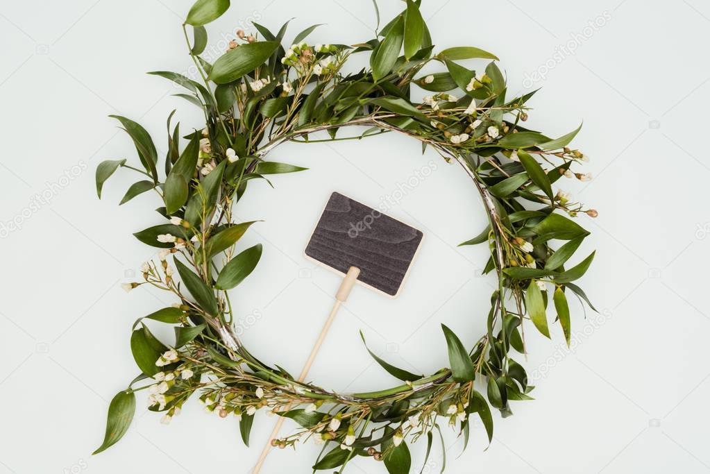 top view of leaves wreath with blackboard isolated on white, earth day concept