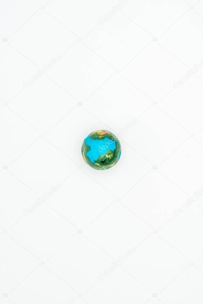 top view of earth model isolated on white, earth day concept