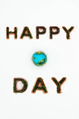 top view of earth model with text happy earth day isolated on white