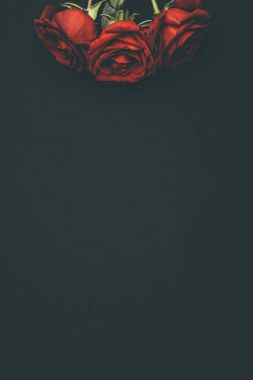 Bouquet of blooming red roses isolated on black