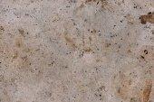 Kamenná zeď praskliny lehké textury pozadí