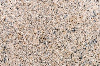 Beige granite stone wall background