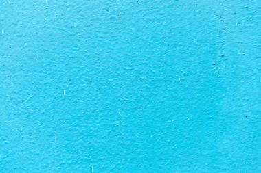 Old blue plaster on wall background