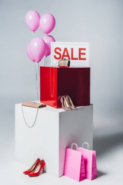 bundle of balloons, pink shopping bags and sale sign, summer sale concept