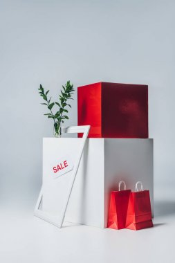 red shopping bags, frame and sale signs, summer sale concept