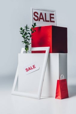 red and white cubes, shopping bag and sale signs, summer sale concept