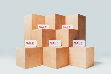 wooden stands with sale signs on white, summer sale concept