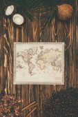 Fotografie top view of vintage map and cigars surrounded with aromatic food aon wooden surface
