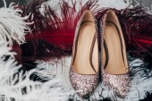 Fotografie close up view of bridal shoes and decorative feathers for rustic wedding
