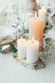Fotografie close up view of stylish table setting with candles and flowers for rustic wedding