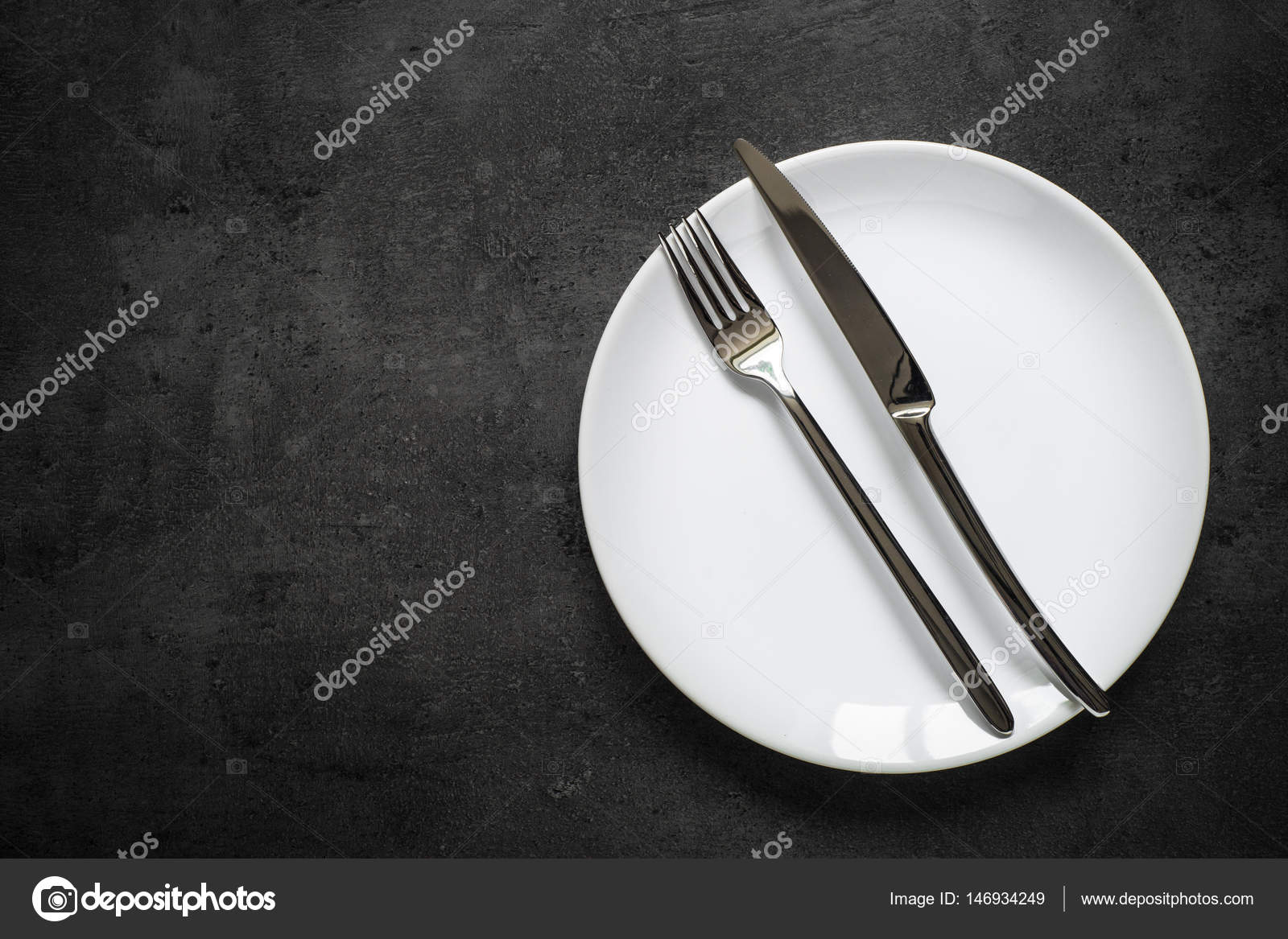 Table setting. Fork knife and white plate at dark slate table. \u2014 Stock Photo & Table setting. Fork knife and white plate at dark slate table ...