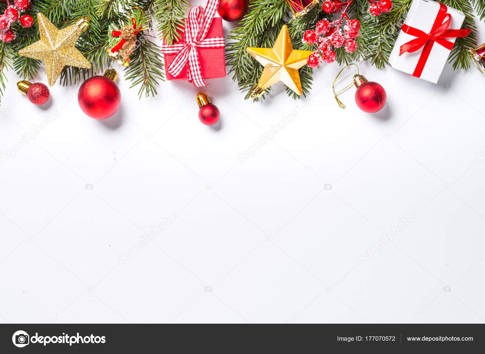 4ac913863755 Christmas background. Red and gold christmas decorations and present box  with snow fir tree branch on white background isolated. Top view with copy  space.