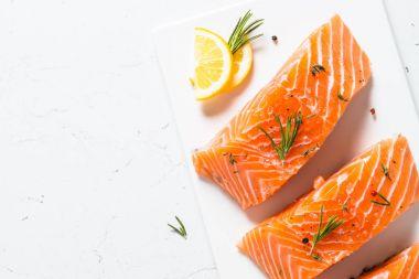 Fresh fish. Salmon fillet on white.