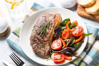 Lunch menu plate. Grilled beef striploin steak with fresh salad. stock vector