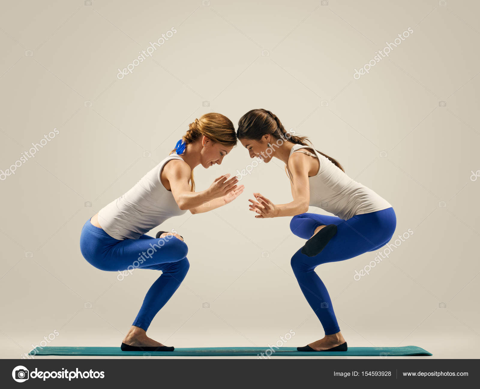 Yoga In Pair Women Duo Balance On One Leg Stock Photo
