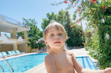 Boy near swimming pool