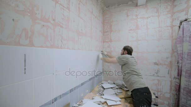 Dismantling ceramic tiles with a chisel and a hammer. — Stock Video ...