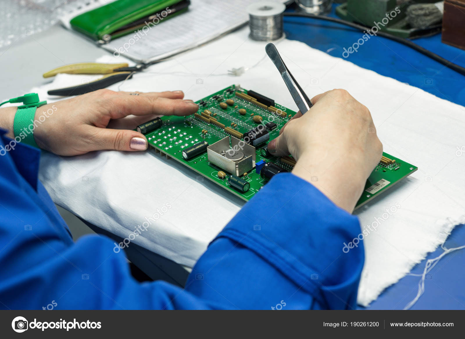 The Process Of Assembling An Electronic Module Workers Hands Completely Assembled Printed Circuit Board Place Components On