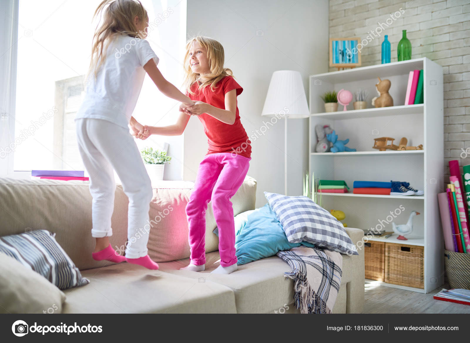 Cute Fair Haired Little Sisters Holding Hands Jumping Cozy