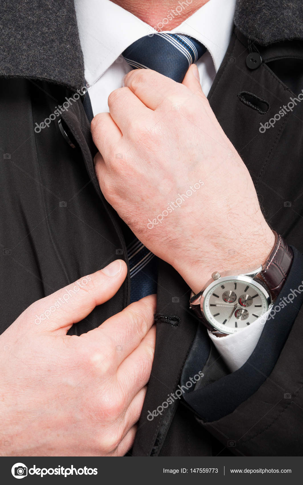 Close-up of elegant man wearing watch arranging his tie — Stock ...