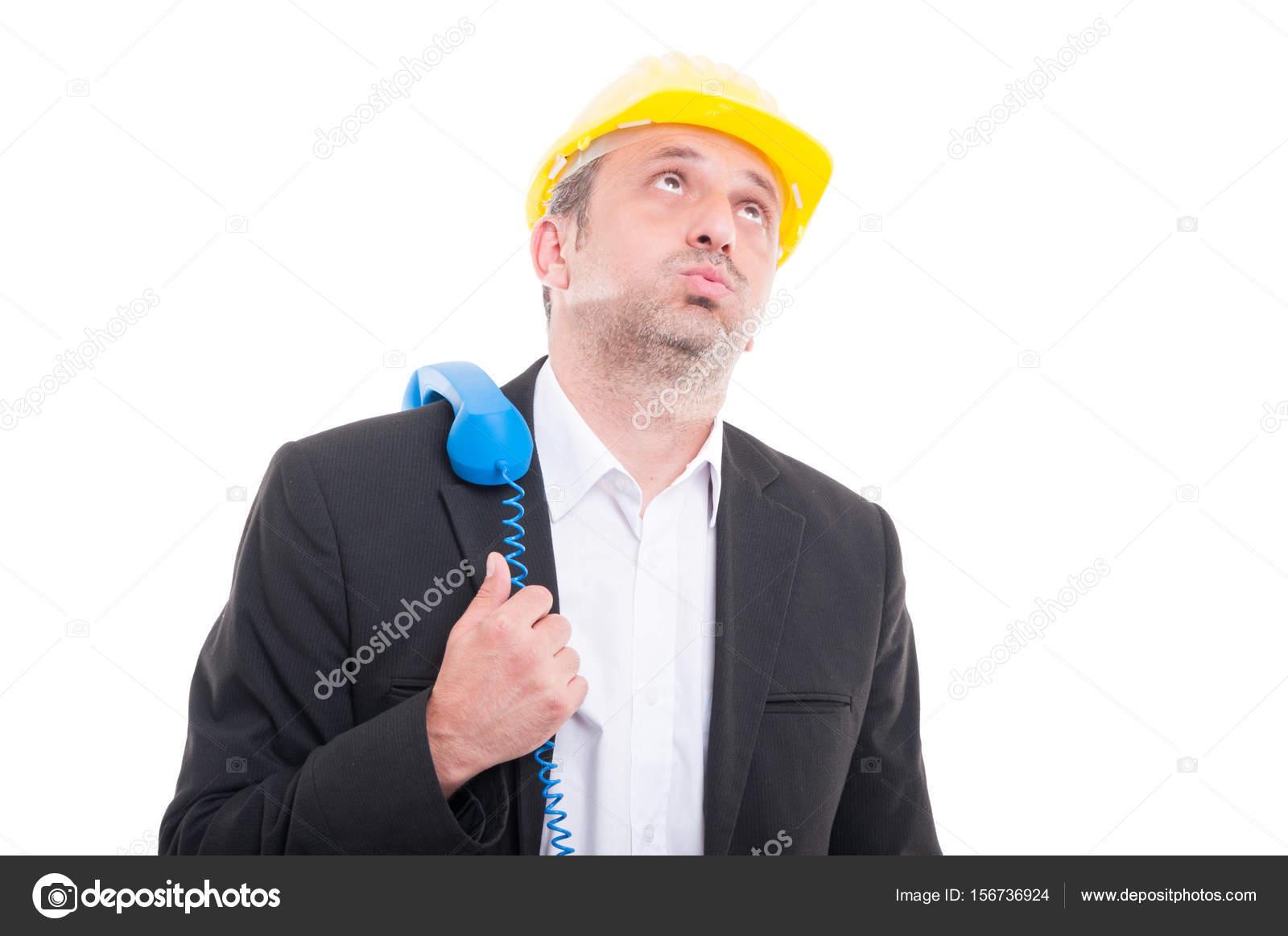 Suche Architekt architekt suche mit telefonhörer auf schulter gebohrt stockfoto