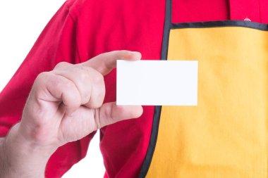 Hypermarket employee holding empty business card