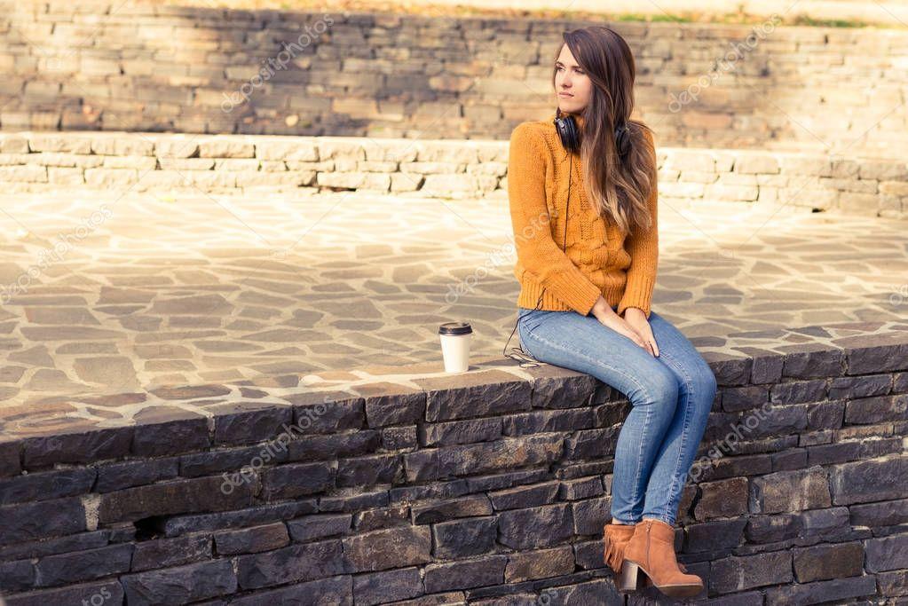 Fashion autumn woman drinks coffee