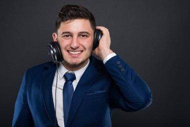Cheerful ceo posing with modern headphones