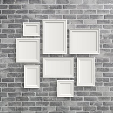 blank frames on grey birck wall