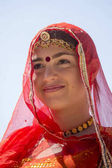 Indian girl wearing traditional Rajasthani dress participate in Desert Festival in Jaisalmer, Rajasthan, India