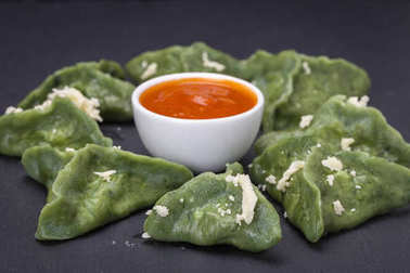 Green dim sum, chinese food. Dumplings with beef meat or mashed potatoes or cottage cheese in the dough with spirulina