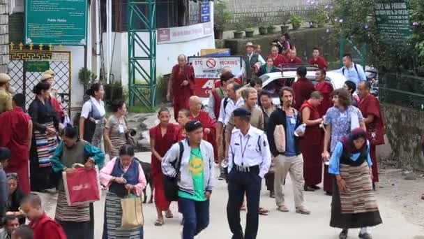 DHARAMSALA, INDIA. Tibetan monks and people from the lessons of the Dalai Lama, Buddhist temple, McLeod Ganj