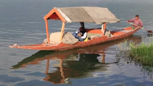 Lifestyle in Dal lake, local people use Shikara, a small boat for  transportation in the lake of Srinagar, Jammu and Kashmir state, India