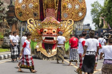 GIANYAR, BALI, INDONESIA - JANUARY 08, 2018 : Barong figure and Unknown Balinese people, participates in street ceremony, during a pre-election rally the Indonesian Democratic Party of Struggle stock vector