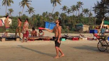 ARAMBOL, GOA, INDIA - FEBRUARY 15, 2017 : Unidentified man juggle on the beach near the sea during sunset . Goa state Arambol beach. India